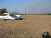 My chartered plane and the grass landing strip cut out of the bush