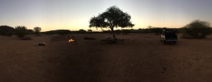 A BBQ in the middle for the bushveld. A cooking fire to the right. Bonfire for light and warmth. Finally a table set fit for a king.