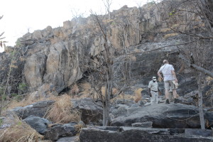 It is a long way up to the petroglyphs. You have to rock climb up to the upper row of grass to see them.