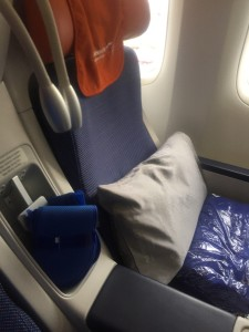 """These are the seats that come with Aeroflot """"Comfort Plus"""" there was plenty of elbow room, and leg room including foot rest that popped up recliner style when you leaned the seat back. The dangley things in the center are reading lights and there is room just below them for a water bottle."""