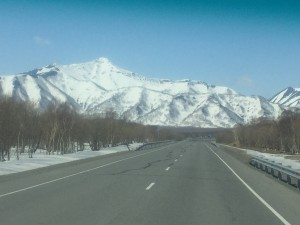 I don't know if it is over or around these mountains but I was going on a snowmobile.